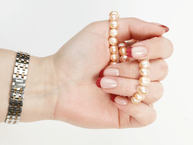 women wear watch with bead bracelet